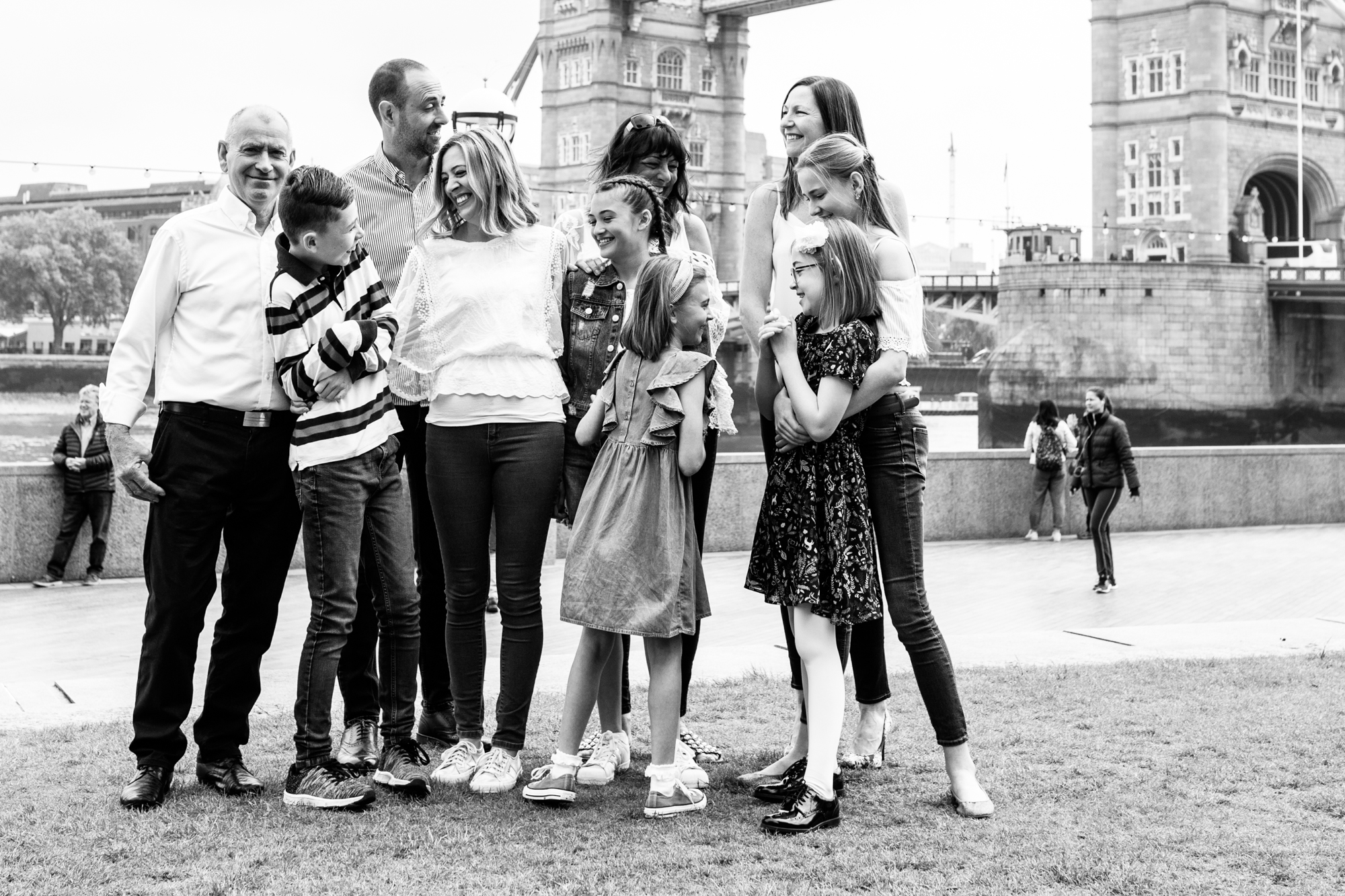 extended family at their family photoshoot in London at Tower Bridge