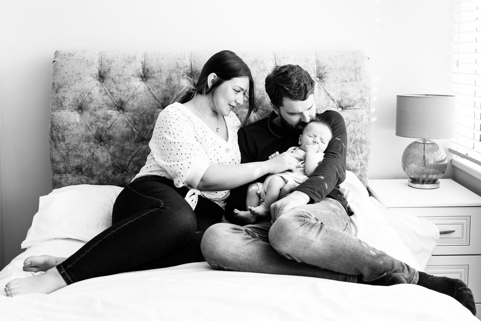 new parents with newborn baby at home newborn photoshoot in Bexley Kent