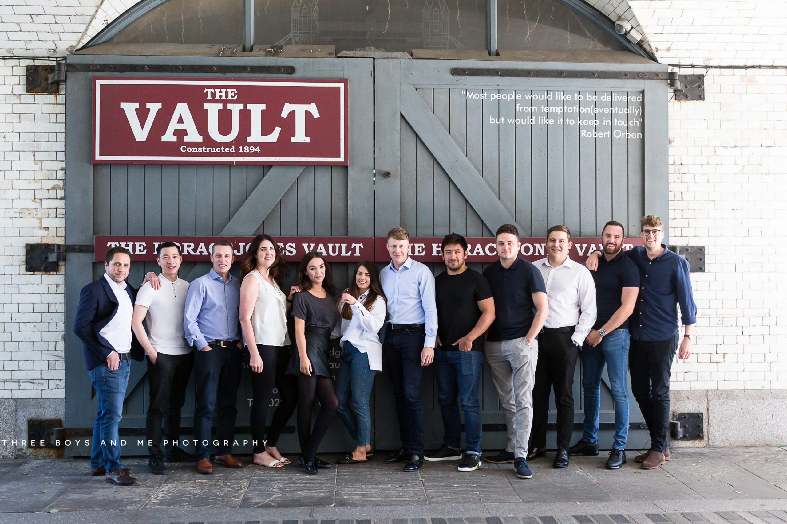 casual team shot by the vault bar at tower bridge London on their commercial photoshoot