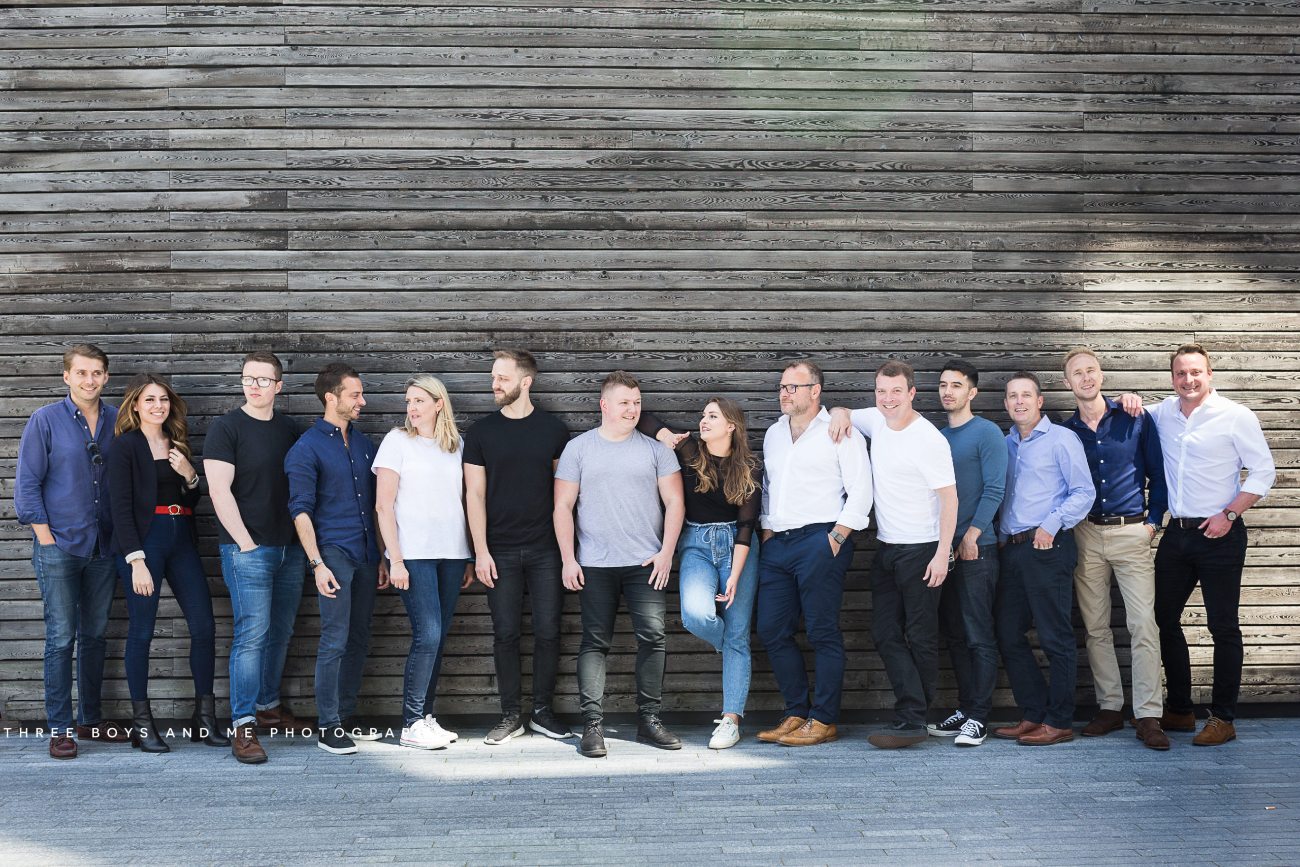 IT recruitment team shot with contemporary wooden background at their meet the team commercial shoot