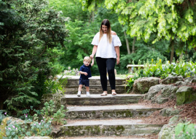 mum and son walking down steps at Lesnes Abbey Ruins in Bexley