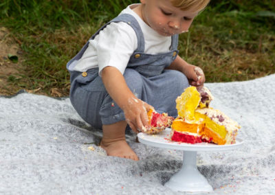 close up photograph of a little boy at his outdoor cakesmash shoot in Bexley