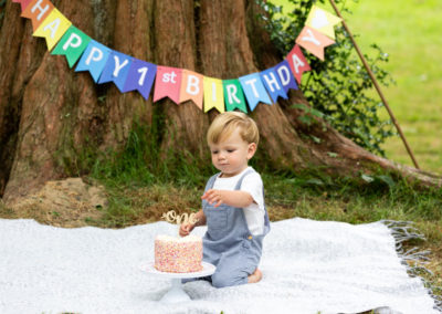 little boy at his outdoor cake smash set up in his Bexley photoshoot