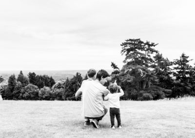 man with two children looking into the distance at Riverhill Himalayan gardens vantage point during a documentary family photoshoot