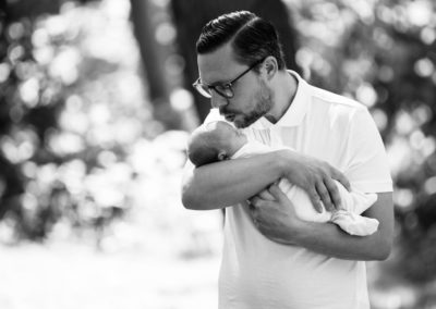 beautiful natural black and white portrait of dad and newborn daughter at their outdoor newborn photoshoot in Bexley