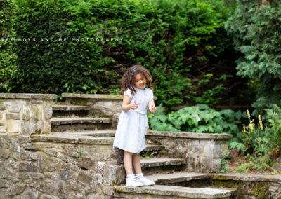natural photograph of a little girl playing and singing in Bexley on her photoshoot