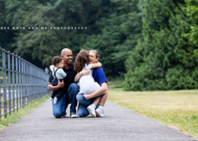 beautiful family of 4 at their babies outdoor cakesmash photoshoot in Bexley