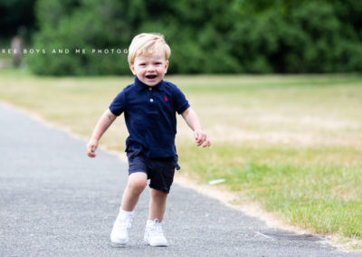 baby boy running and laughing at his natural photoshoot in Bexley
