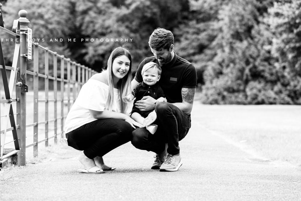 image of parents with small toddler, looking at the camera taken during their family photoshoot in Bexley Kent
