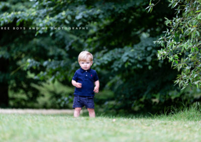 natural image of toddler walking through the grass at his Bexley family photoshoot