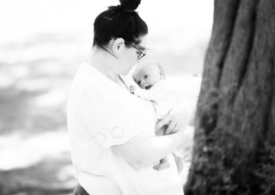 beautiful moment between mum and her newborn daughter at their outdoor newborn shoot Bexley