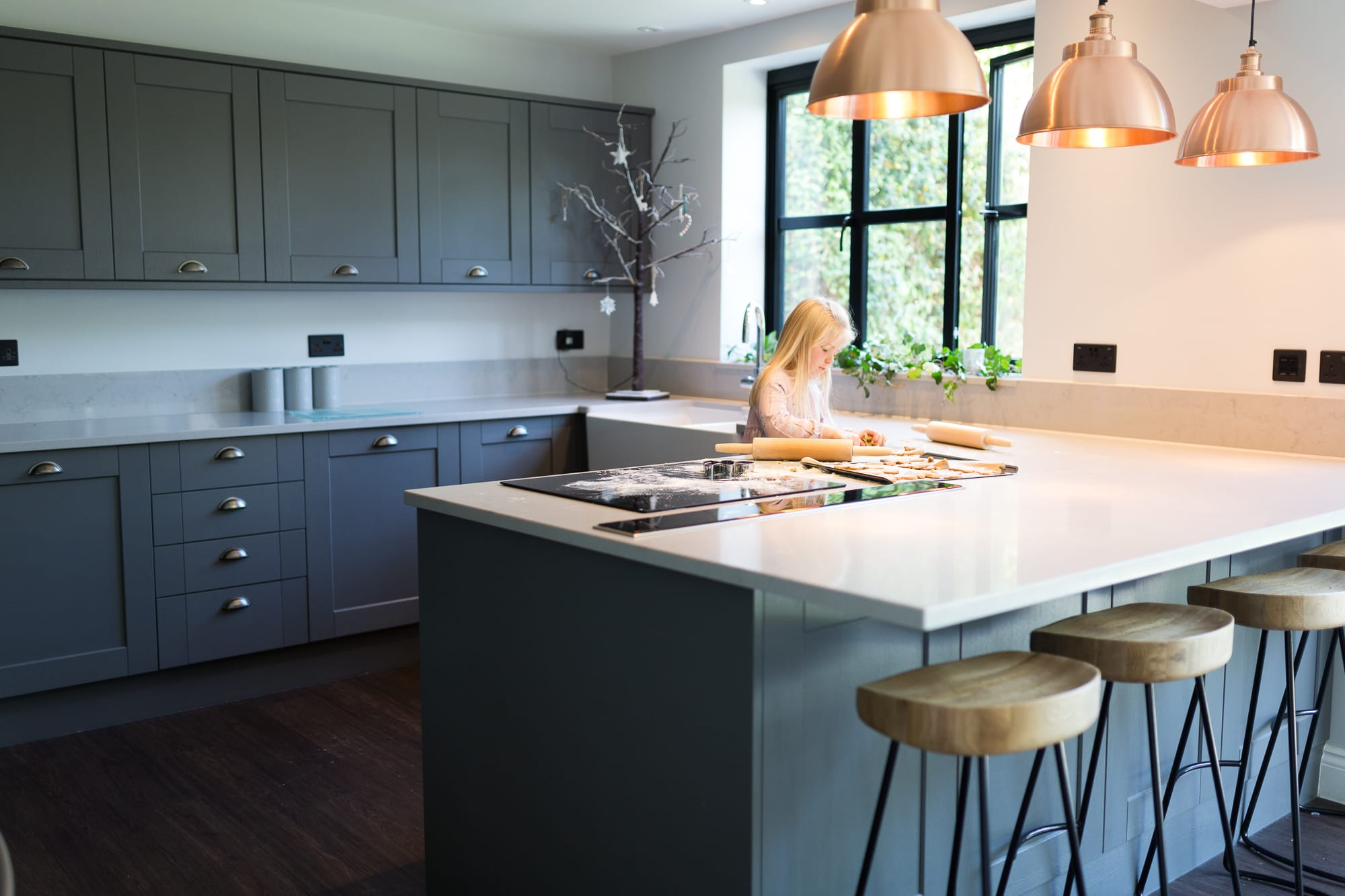 young girl cooking in industrial contemporary kitchen during family photoshoot in Bexley
