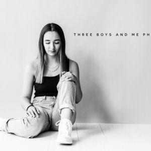 teenager sat on studio floor black and white image taken at her modeling portfolio updates photoshoot in Bexley