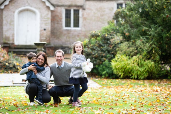 family of four in beautiful natural portrait shot during their autumn family photoshoot in Sevenoaks