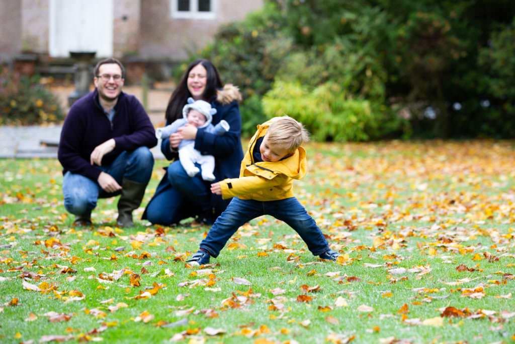 little boy dancing at his autumn family photoshoot in sevenoaks