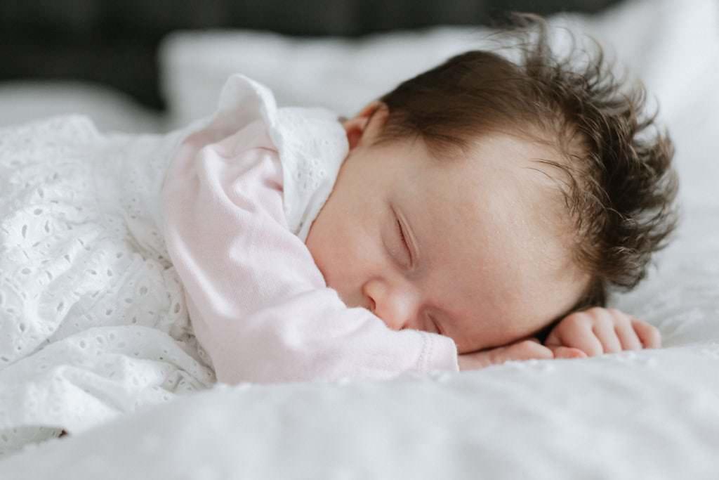 sleeping newborn baby at her newborn family photoshoot in sevenoaks