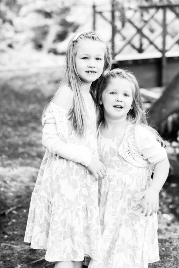 black and white photograph of two sisters at their family photoshoot in sevenoaks